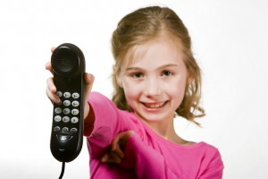Child handing over the telephone